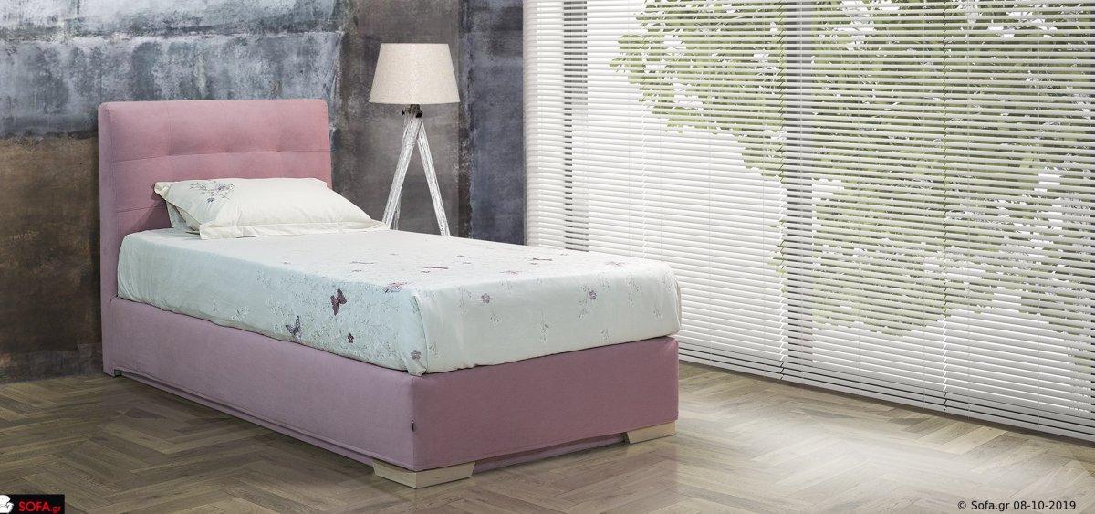 μασίφ υφασμάτινο κρεβάτι μονό σε ρόζ απόχρωση με ύφασμα αποσπώμενο