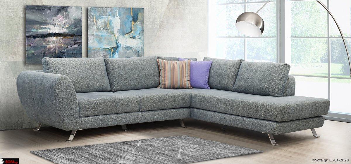 Γωνιακός καναπές μπλέ χρώμα, αποτελούμενος από δύο τεμάχια και ψηλά inox πόδια.