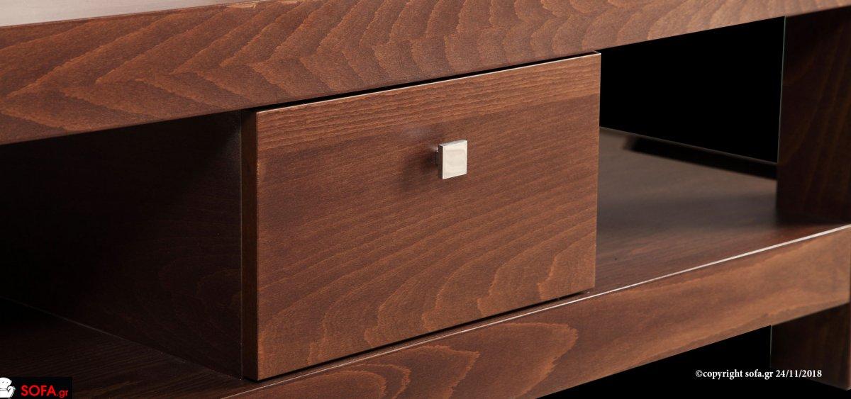 Μοντέρνο τραπεζάκι σαλονιού, με τζάμι στο επάνω μέρος, με δύο συρτάρια και χώρο για περιοδικά.