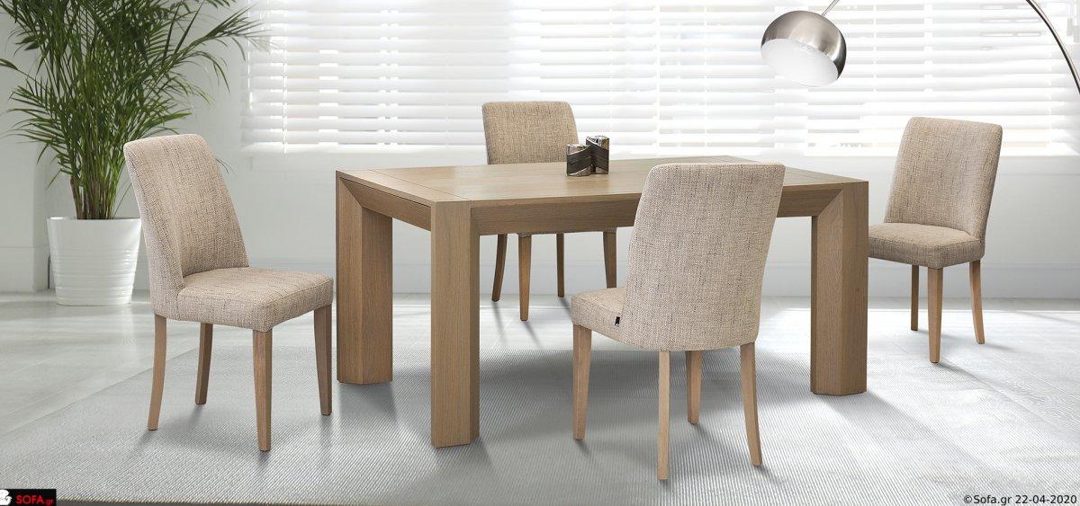Τραπεζαρία με ιδιαίτερο σχέδιο στα πόδια και καρέκλες ντυμένες
